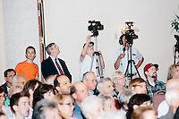 Media photographers work as Republican presidential candidate Dr. Ben Carson speaks at a town hall campaign stop at a meeting of the Windham Republican Town Committee at the Castleton Banquet and Conference Center in Windham, New Hampshire.