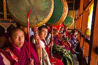 Buddhist monks drumming and watching at the Paro Tsechu (Festival), Paro, Bhutan