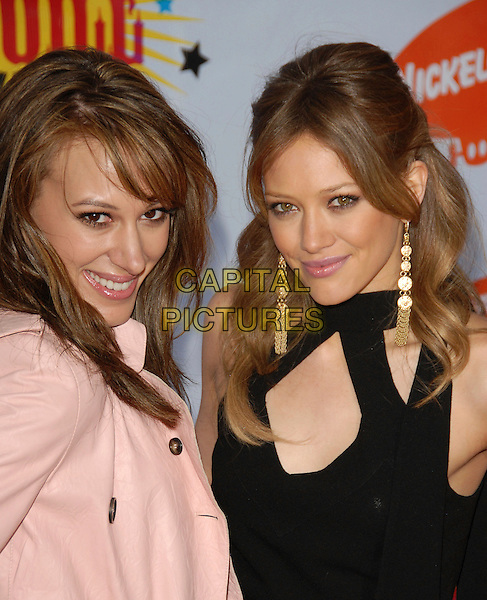 HAYLIE DUFF & HILARY DUFF.Arrivals at The Nickelodeon's 19th Annual Kids' Choice Awards held at UCLA's Pauley Pavilion in Westwood, California, USA, April 1st 2006..half length sisters gold earrings black top cut out .Ref: DVS.www.capitalpictures.com.sales@capitalpictures.com.©Debbie VanStory/Capital Pictures
