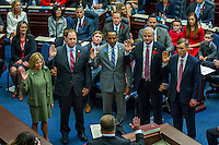 TALLAHASSEE, FLA. Rep. Loranne Aulsey, D-Tallahassee, left, Rep. Jayer Williamson, R-Pace, Rep. Ramon Alexander, D-Tallahassee, Rep. Mel Ponder, R-Destin and Rep. Frank White, R-Pensacola, take the oath of office during the Organizational Session of the legislature at the Capitol in Tallahassee.<br /> <br /> COLIN HACKLEY PHOTO
