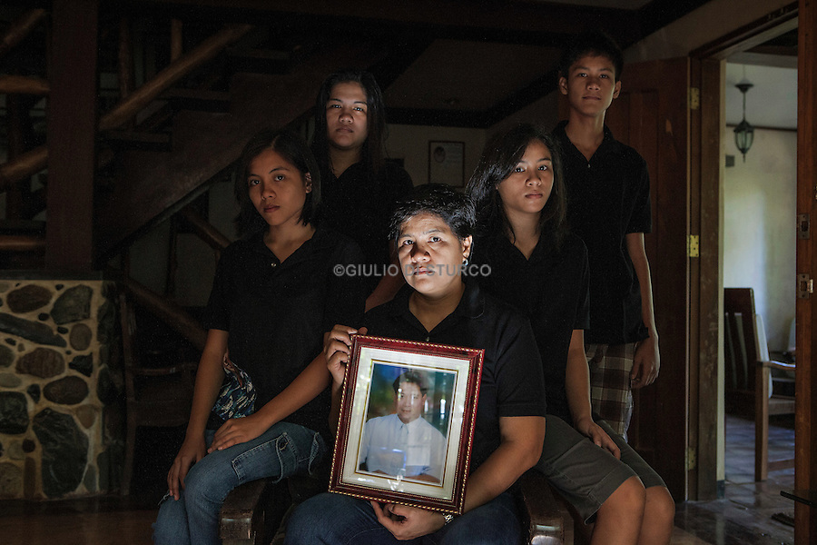 "Doc. Gerry family portrait, Patty, Mika, Erika, Joaquin, Sophia, Keara, Jan 2012..The 24th of Jan was the one year anniversary of the death of Gerardo Ortega, Doc Gerry, the last of the martyrs of Palawan..He was a veterinarian, a fervent Catholic, former director of a major farming state crocodiles. Doc Gerry had a very famous radio program where he spoke almost every day about the scandals and the dangers of mines on the island paradise..Doc Gerry was killed shortly after his program was broadcast in which he denounced in the case of direct funding for ""safety"" of the gas companies.."