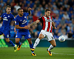 Ashley Richards of Cardiff City and Billy Sharp of Sheffield Utd during the Championship match at the Cardiff City Stadium, Cardiff. Picture date: August 15th 2017. Picture credit should read: Simon Bellis/Sportimage
