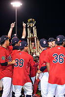Elizabethton Twins players celebrate with the championship trophy after winning the Appalachian League Championship Series against the Princeton Rays 2-1 at Joe O'Brien Field on September 5, 2018 in Elizabethton, Tennessee. (Tony Farlow/Four Seam Images)
