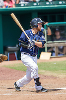 San Antonio Missions second baseman Taylor Lindsey (27) follows through on his swing during the Texas League baseball game against the Midland RockHounds on June 28, 2015 at Nelson Wolff Stadium in San Antonio, Texas. The Missions defeated the RockHounds 7-2. (Andrew Woolley/Four Seam Images)