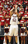 Caleb Forrest (#52), Washington State senior forward, takes a jump shot with the WSU student section (the ZZU CRU) providing support during the Cougars Pac-10 conference game with the Beavers on February 14, 2009, in Pullman, Washington.  Despite a 12 point deficit at halftime, Oregon State came back to win the game 54-52.