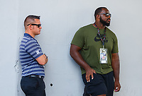 Jun 9, 2017; Englishtown , NJ, USA; Drag Illustrated magazine editor Wes Buck (left) and Philadelphia Eagles defensive tackle Fletcher Cox watch NHRA qualifying for the Summernationals at Old Bridge Township Raceway Park. Mandatory Credit: Mark J. Rebilas-USA TODAY Sports