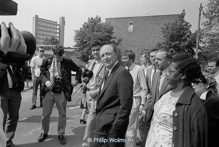 Labour Party leader Neil Kinnock on a tour of Walterton and Elgin Estates in support of the resident-led campaign to take control of their homes from Westminster City Council.  North Paddington, London 1988.