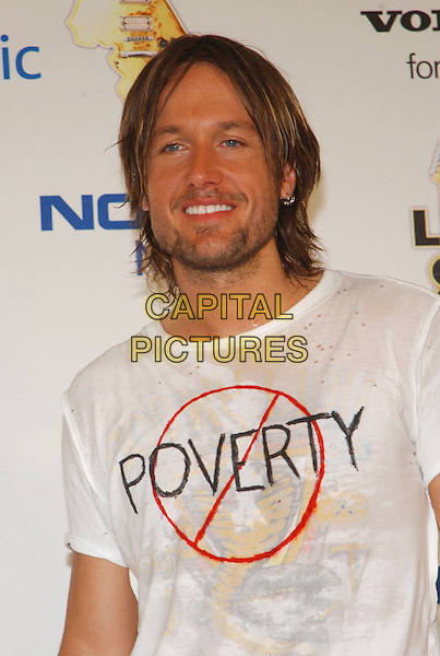 KEITH URBAN.Live 8 Pressroom - Philadelphia, Pennsylvania.Live 8 is a series of nine concerts on four continents the same day to raise awareness to call for an end to extreme poverty in Africa.  .July 2nd, 2005.Photo Credit: George Shepherd/AdMedia.headshot portrait poverty t-shirt t shirt logo slogan stubble facial hair.www.capitalpictures.com.sales@capitalpictures.com.© Capital Pictures.