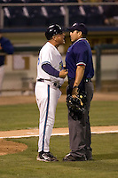 August 4, 2009: Home plate umpire Javier Cantu gets an earful from Everett AquaSox manager John Tamargo during a Northwest League game between the AquaSox and Boise Hawks at Everett Memorial Stadium in Everett, Washington.