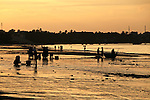 Fishermen on the beach are silhouetted against the rising sun in Mui Ne, Vietnam. <br /> Nov. 11, 2011.