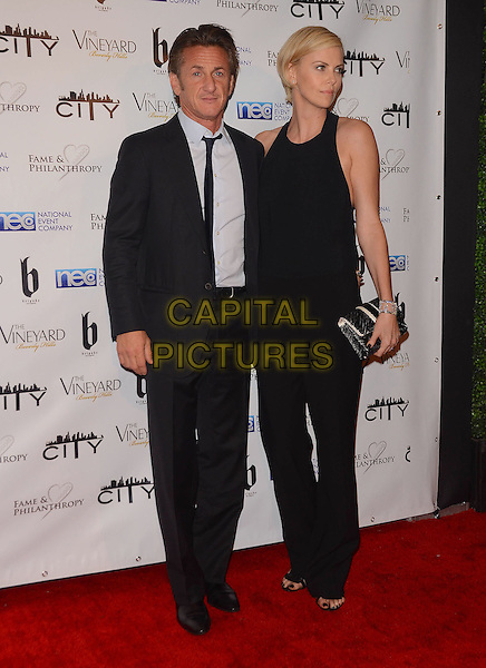 02 March 2014 - Beverly Hills, California - Sean Penn, Charlize Theron.  Fame and Philanthropy Post-Oscar Gala celebrating the 86th Annual Academy Awards held at The Vineyard Beverly Hills. <br /> CAP/ADM/BT<br /> &copy;Birdie Thompson/AdMedia/Capital Pictures