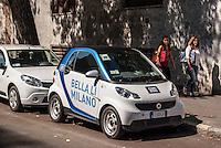 "Milano, una Smart del servizio di car sharing Car2go, con la scritta ""bella lì Milano"" --- Milan, Car2go car sharing"