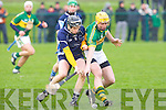Kerry's Tom Murnane and IT Tralee's Colum Harty fight for the ball in the Waterford Crystal Cup at Abbeydorney on Sunday..
