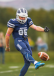 8 October 2016: Middlebury College Panther Wide Receiver Maxwell Rye, a Freshman from Longmeadow, MA, punts on 4th down to the Amherst College Purple & White at Alumni Stadium in Middlebury, Vermont. The Panthers edged out the Purple & While 27-26. Mandatory Credit: Ed Wolfstein Photo *** RAW (NEF) Image File Available ***