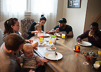 Olympic Gold champion wrestler Jordan Burroughs (cq) and his family host a breakfast with friends and wrestlers at their home in Lincoln, Nebraska, Saturday, February 13, 2015. Burroughs still trains at the university where he wrestled as a student.<br /> <br /> Photo by Matt Nager