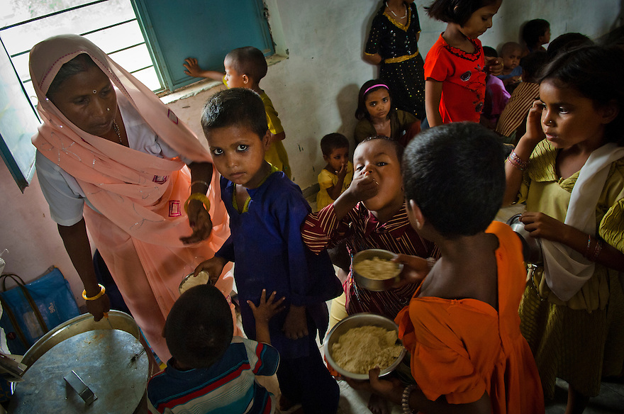 Children from the local community spend their day a Anganwadi centre in the village of Shoi in Wajirganj block.