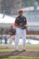 Batavia Muckdogs relief pitcher Nestor Bautista (39) gets ready to deliver a pitch in the rain during a game against the West Virginia Black Bears on June 25, 2017 at Dwyer Stadium in Batavia, New York.  Batavia defeated West Virginia 4-1 in nine innings of a scheduled seven inning game.  (Mike Janes/Four Seam Images)