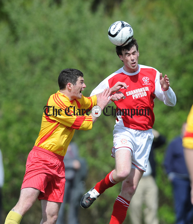 Simon Cuddy of Avenue United in action against Enda Kelly of Newmarket during their game at Lees road. Photograph by John Kelly.