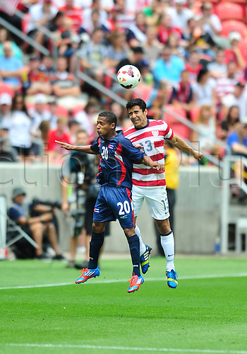 13.07.2013. Sandy, Utah, USA. Tony Beltran (13) from USA and Alberto Gomez (20) from Cuba during the game. The U.S. Men's National Team defeated the Cuba 4-1 Concacaf Gold Cup at Rio Tinto Stadium in Sandy, Utah.