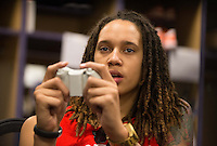 Jun. 10, 2013; Phoenix, AZ, USA: Phoenix Mercury center Brittney Griner plays NBA 2K13 on an Xbox in the teams locker room at the US Airways Center. Mandatory Credit: Mark J. Rebilas-