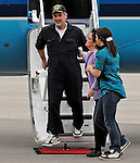 17 April 2009: Flying on a Maersk corporate jet, Captain Richard Phillips steps onto US soil for the first time and is greeted by family members after completing an 18-hour journey home from Mombasa, Kenya, arriving at the Burlington International Airport, in Burlington, Vermont, USA 17 April 2009. Phillips was held hostage for five days by Somali pirates in an attempted hijacking of the Maersk cargo ship Alabama. United States Navy Seal sharpshooters on the USS Bainbridge killed three pirates to free Captain Phillips in his dramatic rescue.