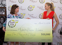 LAS VEGAS, NV - April 5 : Pure Via Marketing Director Cheryl Gill and Jewel pictured as Jewel accepts 10K donation from Pure Via on behalf of Project Clean Water and kicks off partnership with Pure Via at ACM Party For A Cause at The Linq in Las Vegas, NV on April 5, 2014. © Kabik/ Starlitepics ***HOUSE COVERAGE***