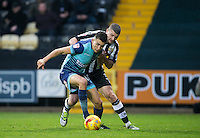 Luke O'Nien of Wycombe Wanderers holds off Carl Dickinson of Notts Co during the Sky Bet League 2 match between Notts County and Wycombe Wanderers at Meadow Lane, Nottingham, England on 10 December 2016. Photo by Andy Rowland.