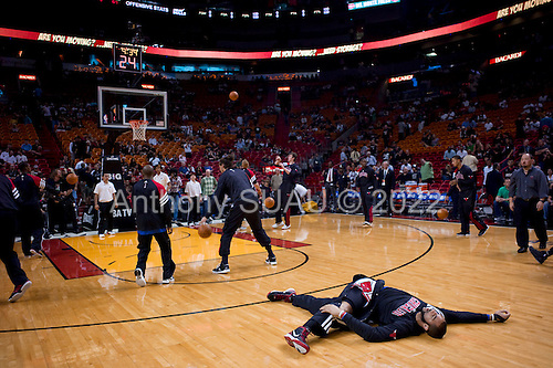 Miami, Florida<br /> January 29, 2012<br /> <br /> As fans file in to the American Airlines Arena and take their seats the Chicago BULLS and the Miami HEAT stretch and warm up on the court.