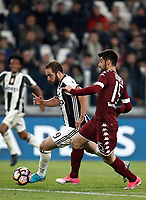 Calcio, Serie A: Torino, Juventus Stadium, 6 maggio 2017. <br /> Juventus' Gonzalo Higuain (r) in action with Torino's Marco Benassi (l) during the Italian Serie A football match between Juventus and Torino at Torino's Juventus stadium, May 6, 2017.<br /> UPDATE IMAGES PRESS/Isabella Bonotto