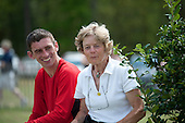 Jockey Brian Crowley and trainer Janet Elliot sit in the sun in the paddock at Ford Conger Field between races.