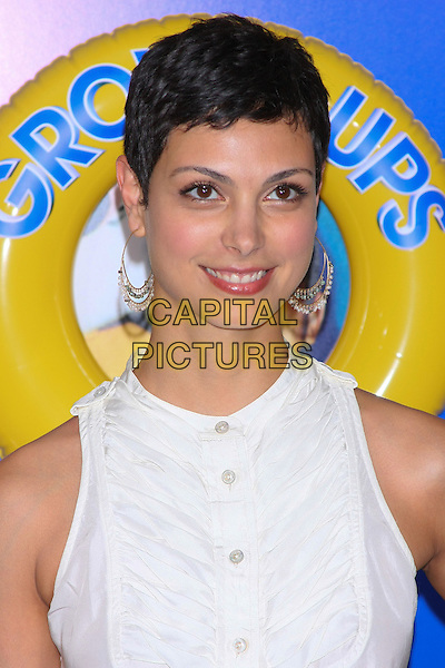 "MORENA BACCARIN.The New York Premiere of ""Grown Ups"" at the Ziegfeld Theater, New York, NY, USA..June 23rd, 2010.headshot portrait hoop earrings gold white sleeveless shirt blouse.CAP/LNC/TOM.©TOM/LNC/Capital Pictures."