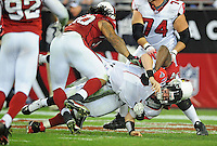 Jan. 3, 2009; Glendale, AZ, USA; Atlanta Falcons quarterback Matt Ryan is tackled for a safety by Arizona Cardinals defensive end (94) Antonio Smith and defensive tackle (90) Darnell Dockett in the fourth quarter during the NFC Wild Card Playoff Game at University of Phoenix Stadium. The Cardinals defeated the Falcons 30-24. Mandatory Credit: Mark J. Rebilas-