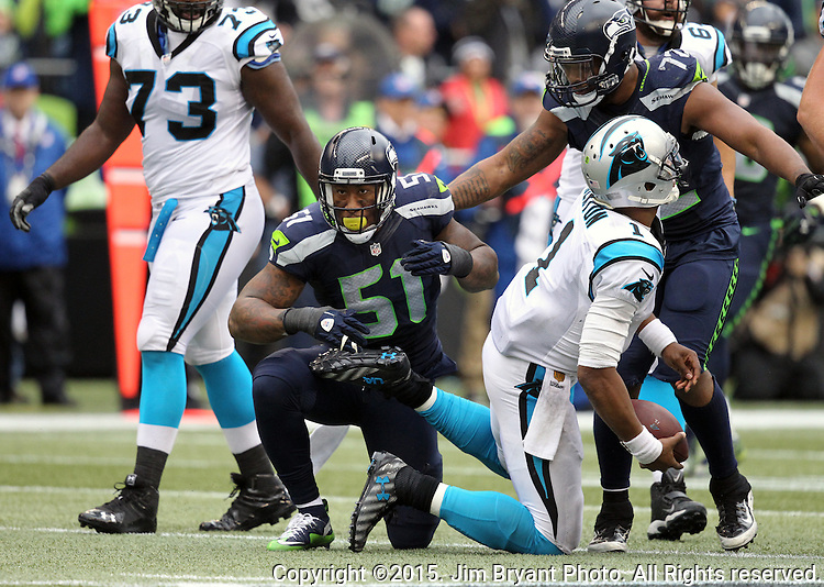 Seattle Seahawks linebacker Bruce Irvin (51) celebrates after sacking Carolina Panthers Kam Newton (1) at CenturyLink Field in Seattle on October 18, 2015. The Panthers came from behind with 32 seconds remaining in the 4th Quarter to beat the Seahawks 27-23.  ©2015 Jim Bryant Photography. All Rights Reserved.