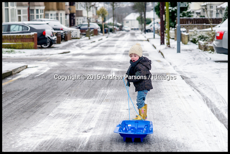 Image ©Licensed to i-Images Picture Agency. 03/02/2015. London, United Kingdom. Snow hits London. Yasmin 4, and Isaac 2, Attwood play in they snow in Woodford Green, North East London, Picture by Andrew Parsons / i-Images