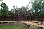 Angkorian temple Banteay Srei (late 10th century) 967.<br /> View towards Gopura II and the central sanctuary.<br /> Banteay Srei temple is situated 20km north of Angkor, built during the reign of Rajendravarman by Yajnavaraha, one of his counsellors. In antiquity Isvarapura was a small city that grew up around the temple. Banteay Srei was dedicated to the worship of Shiva, the foundation stele describes the consecration of the linga Tribhuvanamahesvara (Lord of the three worlds) in 967.