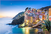 Morning in the village of Riomaggiore is a great experience. Get up early and you will have the harbor all to yourself - except for a few locals who are preparing for the day. In this Cinque Terre town, life is peaceful, but getting more crowded during the days with more and more tourists discovering this gem.
