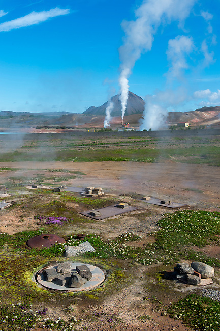 View of the Krafla Geothermic Power Station at Lake Myvatn in Northeast Iceland with underground ovens for rugbrauth (Icelandic Lava Bread) which is baked using geothermal energy in the foreground.