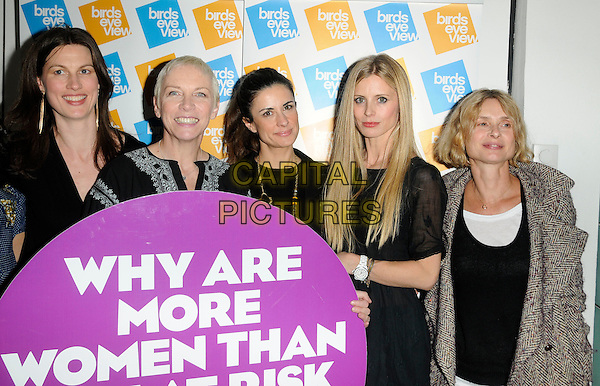 """RACHEL WILLIAMS, ANNIE LENNOX, LIVIA GIUGGIOLI,  LAURA BAILEY & MARYAM D'ABO.At the """"Equals On Film"""" Gala Screening, Birds Eye View Film Festival, Institute of Contemporary Arts, The Mall, London, England, UK, 13th March 2011..half length black dress tunic blazer jacket navy blue holding sign writing slogan   top beige coat .CAP/CAN.©Can Nguyen/Capital Pictures."""