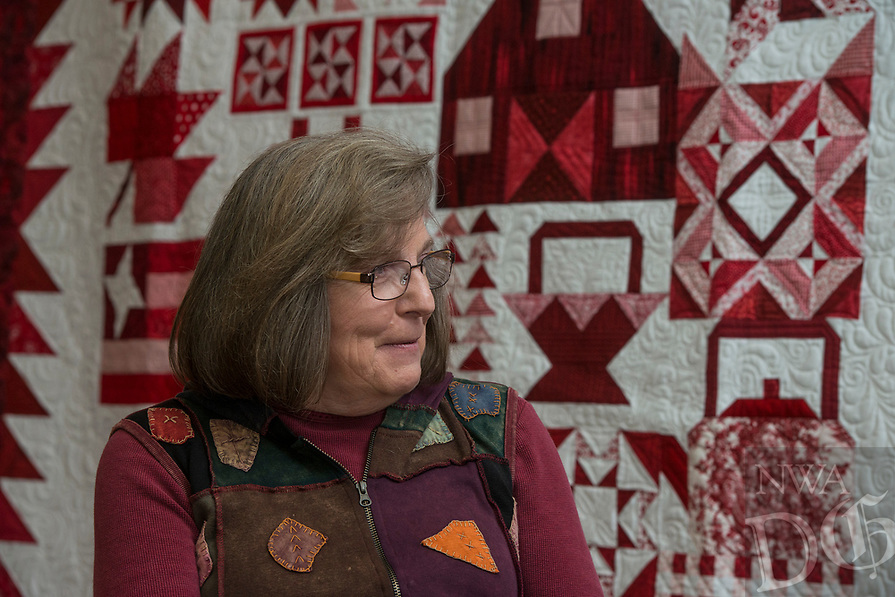 NWA Democrat-Gazette/ANTHONY REYES @NWATONYR<br /> Barbara Hamernik talks Monday, April 3, 2017 backdropped by her quilt &quot;Farm Girl Goes Red and White&quot; at the Shiloh Museum in Springdale. The quilt won Judge's Choice and First Place Pieced, Twin/Full Size Category in the Tomorrow's Heirlooms XVI quilt show.