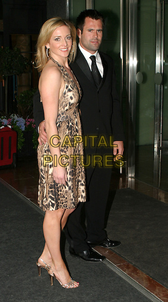 GABY LOGAN & KENNY LOGAN.Tommy's Sports Ball.May 18th, 2004.full length, full-length, animal print, leopard print dress.www.capitalpictures.com.sales@capitalpictures.com.© Capital Pictures.