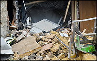 BNPS.co.uk (01202 558833)<br /> Pic: GrahamHunt/BNPS<br /> <br /> Epic Fail...the cash machine still remains in the rubble.<br /> <br /> Inept ram raiders have demolished half the wall of a furniture showroom in the sleepy Dorset town of Beaminster last night.<br /> <br /> The cash machine is still to believed to be in the rubble and the robbers were forced to abandon the tractor used in the raid.