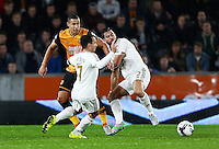 Jake Livermore of Hull City in between Leon Britton and Jordi Amat of Swansea City during the Capital One Cup match between Hull City and Swansea City played at the Kingston Communications Stadium, Hull