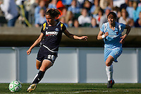 Camille Abily (20) of the Los Angeles Sol is chased by Jenny Hammond (2) of Sky Blue FC. The Los Angeles Sol defeated Sky Blue FC 2-0 during a Women's Professional Soccer match at TD Bank Ballpark in Bridgewater, NJ, on April 5, 2009. Photo by Howard C. Smith/isiphotos.com