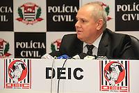 SÃO PAULO,SP,08.05.2015 - CRIME-SP -O Delegado Emygdio Machado Neto Diretor do DEIC durante coletiva de imprensa onde a Polícia Civil na sede do DEIC na região norte da cidade de São Paulo onde prendeu o responsável pela logística de uma quadrilha de roubo de cargas, que assaltou o depósito de uma rede de lojas, em Louveira, no interior de São Paulo. O vendedor Pedro Paulo de Oliveira 47 anos, foi preso na tarde de quinta-feira (7), em Indaiatuba, região de Campinas. Reprodução de fotos.(Foto Marcio Ribeiro / Brazil Photo Press)