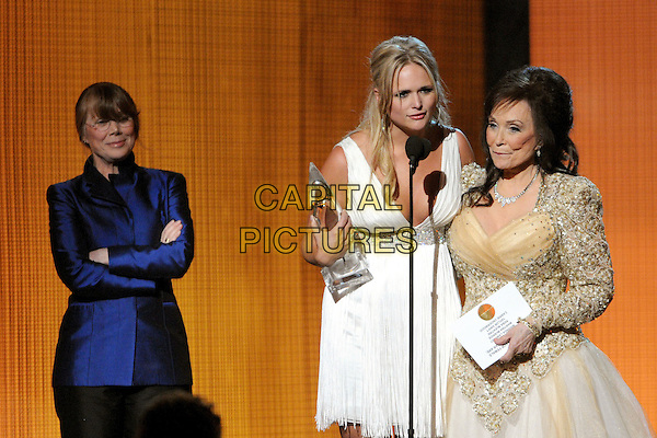 SISSY SPACEK, MIRANDA LAMBERT & LORETTA LYNN.44th Annual CMA Awards, Country Music's Biggest Night, held at Bridgestone Arena, Nashville, Tennessee, USA.  .November 10th, 2010.stage concert live gig performance music half length black white gold embellished jewel encrusted dress singing blue jacket arms crosses trophy .CAP/ADM/LF.©Laura Farr/AdMedia/Capital Pictures.