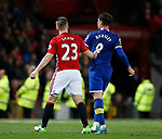 Luke Shaw of Manchester United tries to hurry Ross Barkley of Everton off the pitch as he is substituted during the English Premier League match at Old Trafford Stadium, Manchester. Picture date: April 4th 2017. Pic credit should read: Simon Bellis/Sportimage