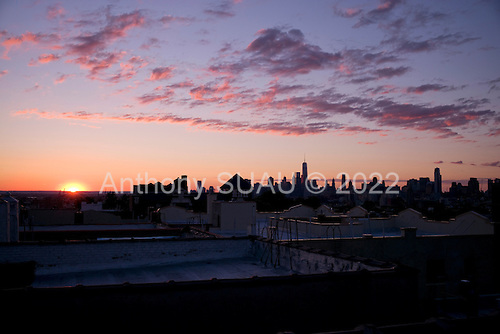 Brooklyn, New York<br /> July 4, 2014<br /> <br /> Sunset and 4th of July Fireworks over Manhattan.