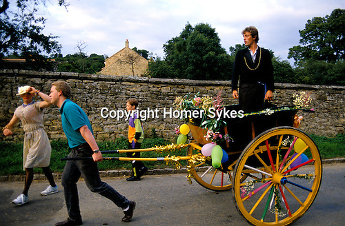 """PROCESSION WITH """"MAYOR"""" ON CART & """"MAYORESS"""" WALKING - MAN DRESSES IN WOMEN'S CLOTHES. KILBURN FEAST YORKSHIRE."""
