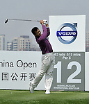 SUZHOU, CHINA - APRIL 16:  Chen Jian of China tees off on the 12th hole during the Round Two of the Volvo China Open on April 16, 2010 in Suzhou, China. Photo by Victor Fraile / The Power of Sport Images