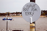White bat to wave for ferry boat Felixstowe Ferry to Bawdsey, River Deben, Suffolk